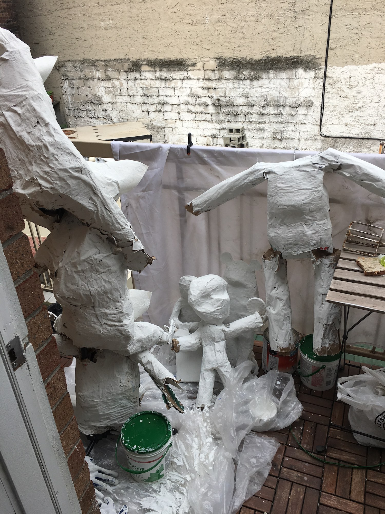 Most of what we've seen so far, now covered in white paint and hanging out on the patio