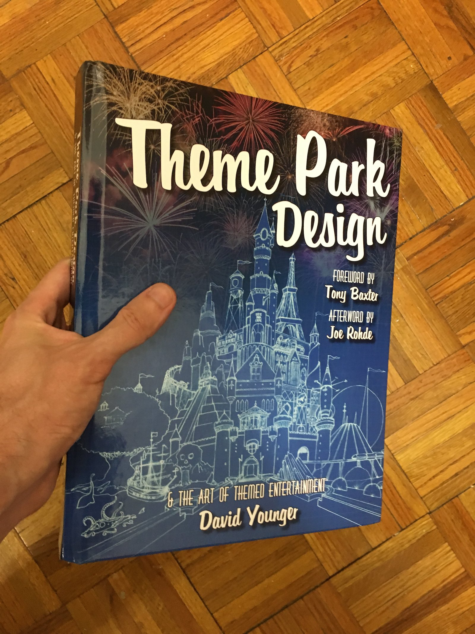David Younger's Theme Park Design, held in my hand. It's huge.