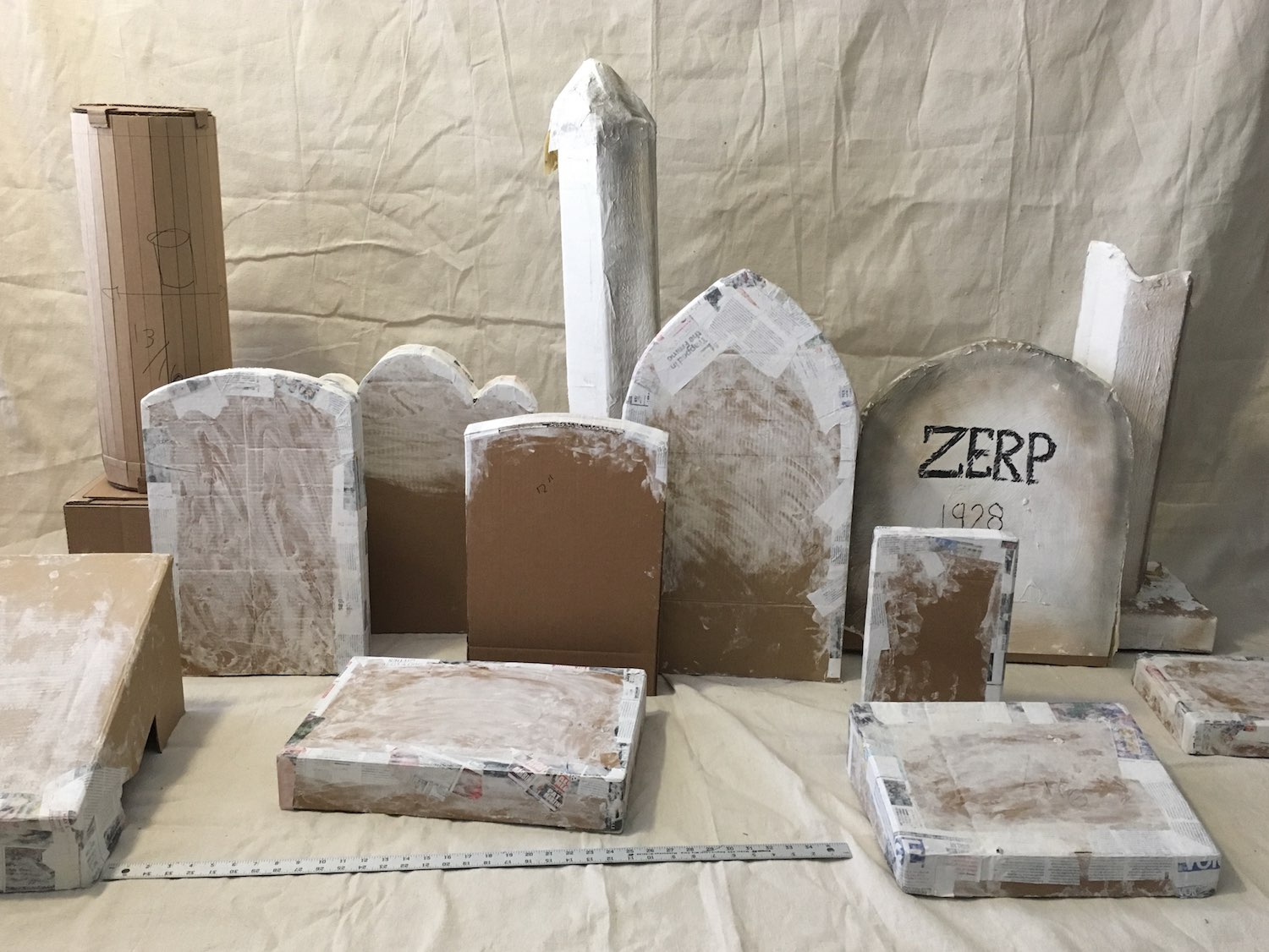Cardboard and papier-mâché grave markers in progress