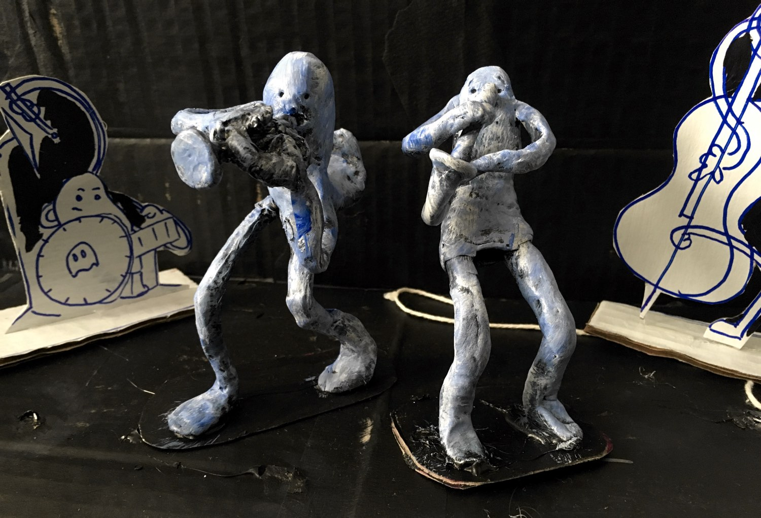 Two ghosts, sculpted out of clay and placed in the model