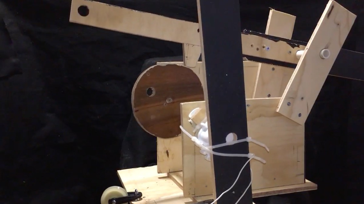 A mockup of the animation rig in plywood.
