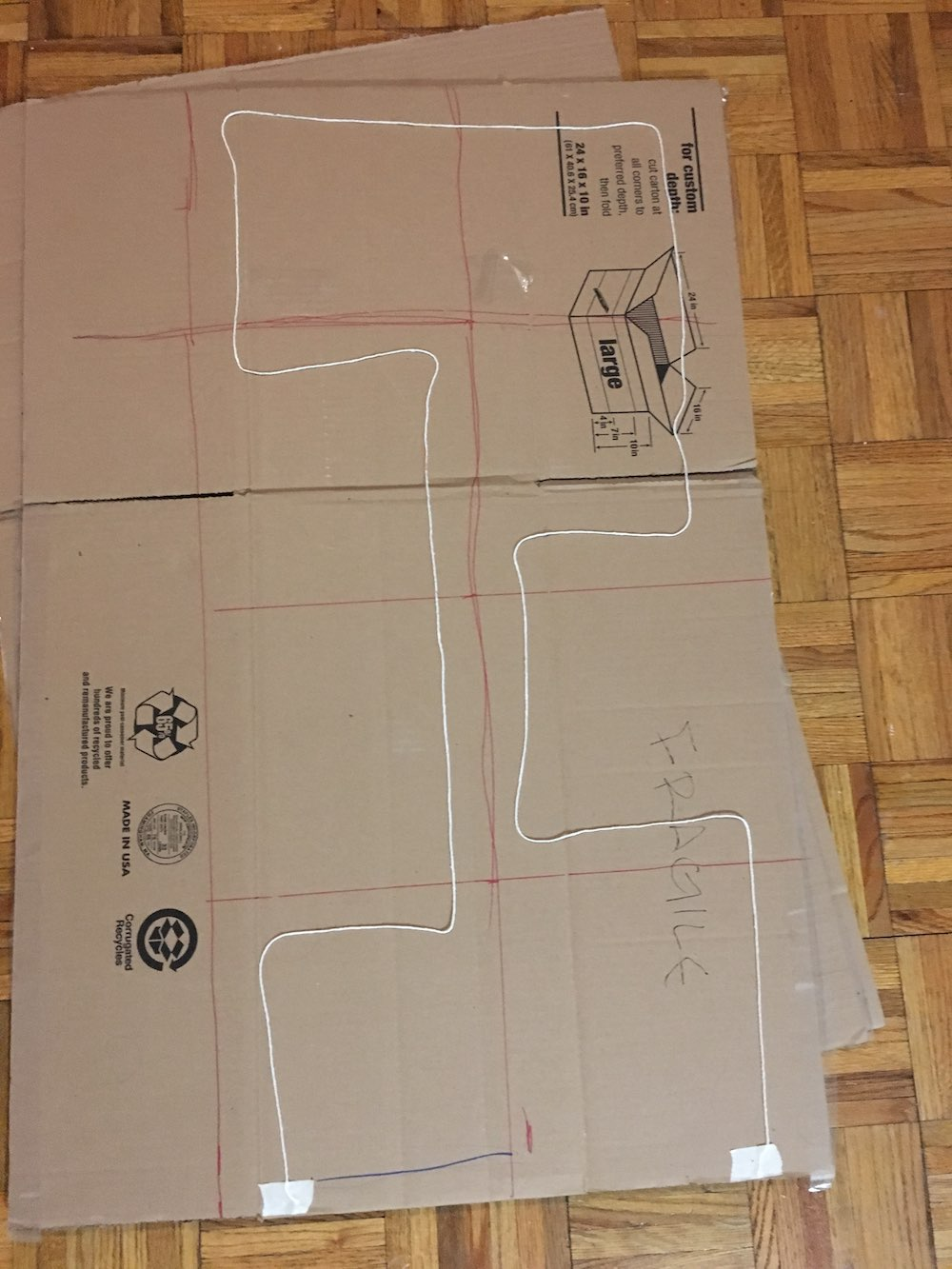 String laid out on cardboard in the shape of a path
